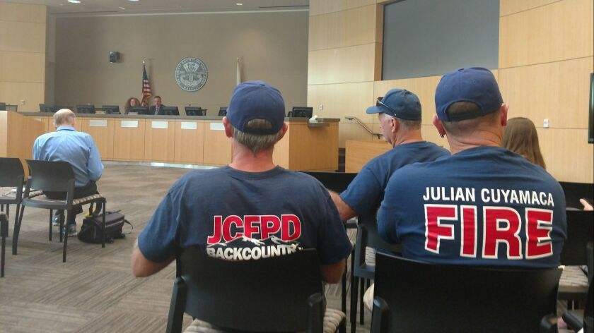 Volunteers with the Julian Cuyamaca Fire Protection District await the results of a protest vote cou