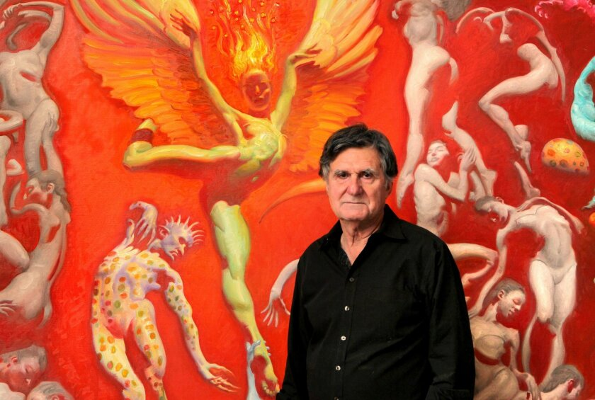 """Portrait of artist John Asaro in his studio in front of a section of his large painting titled, """"Firebird Ballet."""""""