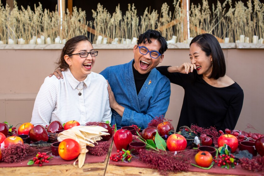 """Scenic designers Tanya Orellana, left, and Carlo Maghirang, center with projection designer Hana S. Kim, on the set of """"Sweet Land."""""""