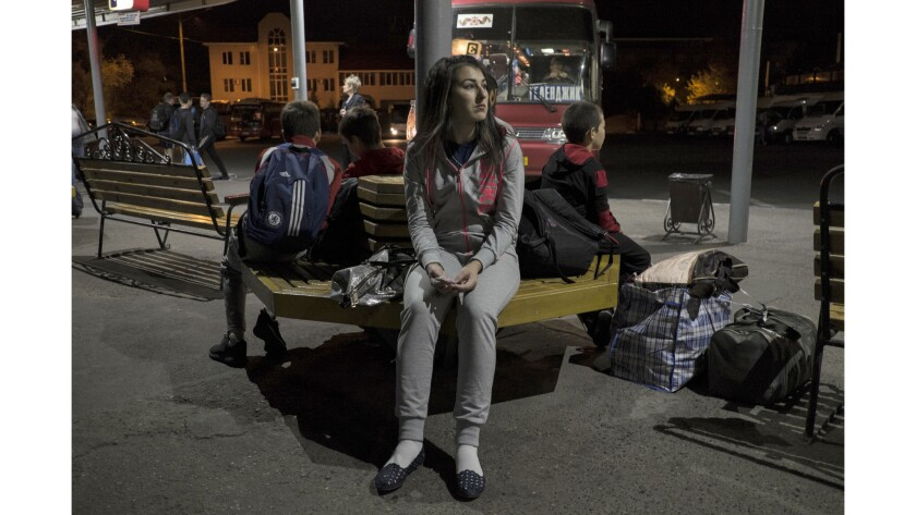 Indira Karakayeva is seen waiting for a bus to Dagestan to visit her parents at a bus station in Sta