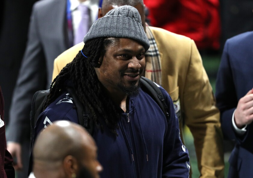 Marshawn Lynch attends activities at Super Bowl LIII in Atlanta.