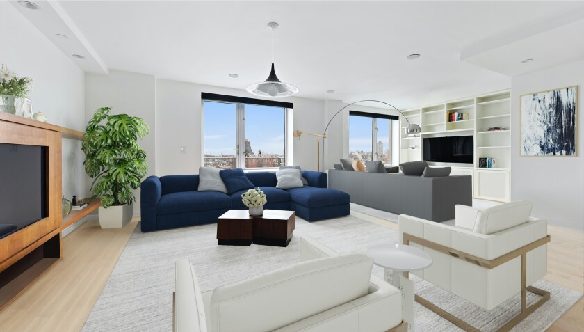 The three-bedroom unit includes a private balcony and access to a rooftop deck.