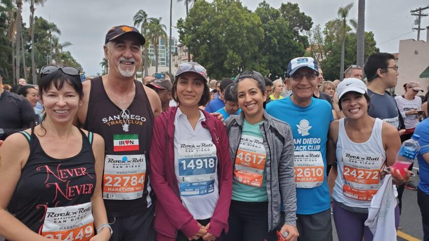 Ghazinouri with members of the San Diego Track Club prior to the start of the 2019 San Diego Rock 'n' Roll Marathon.<br>