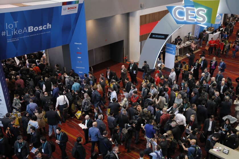 Crowds enter the convention center on the first day of the CES tech show, Tuesday, Jan. 7, 2020, in Las Vegas. (AP Photo/John Locher)