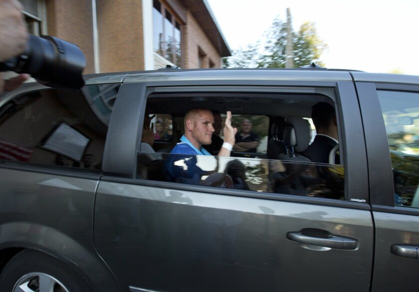 U.S. Spencer Stone waves as he leaves the police station in Arras, northern France, Saturday, Aug. 22, 2015. A gunman prepared to open fire with an automatic weapon on a high-speed train traveling from Amsterdam to Paris Friday, wounding several people before being subdued by passengers, officials said. Spencer Stone is one of the passengers credited with subduing the gunman. (AP Photo/Virginia Mayo)