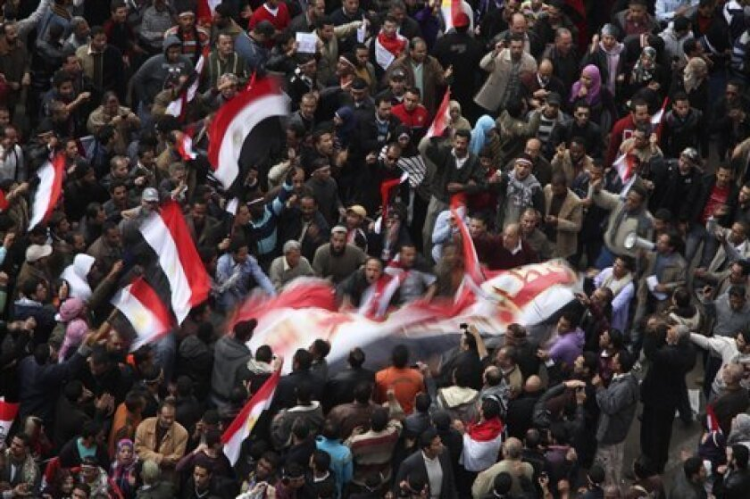Anti-government protesters demonstrate after traditional Muslim Friday prayers at the continuing demonstration in Tahrir Square in downtown Cairo, Egypt, Friday, Feb. 11, 2011. (AP Photo/Tara Todras-Whitehill)
