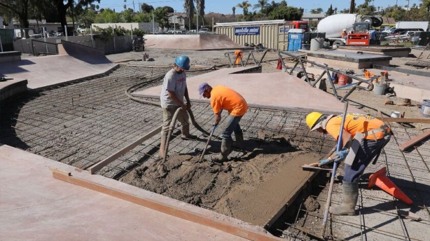 A crew poured concrete Thursday at one of the two skate parks under construction on N. Santa Fe Avenue in Vista. The workers, left to right, are Rob Vincent, Bryan Hartman and David Sotelo.