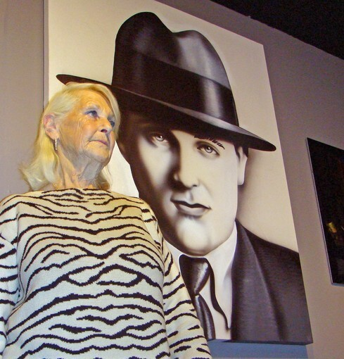 """Millicent Siegel Rosen stands in front of a portrait of her father, """"Bugsy"""" Siegel, at the new Mob Experience at the Tropicana in Las Vegas. """"He pushed Vegas to become what it is today,"""" she said of her father, who founded the Flamingo."""