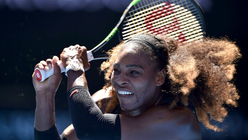 Serena Williams returns a shot against Nicole Gibbs during their third-round match at the Australian Open on Saturday.