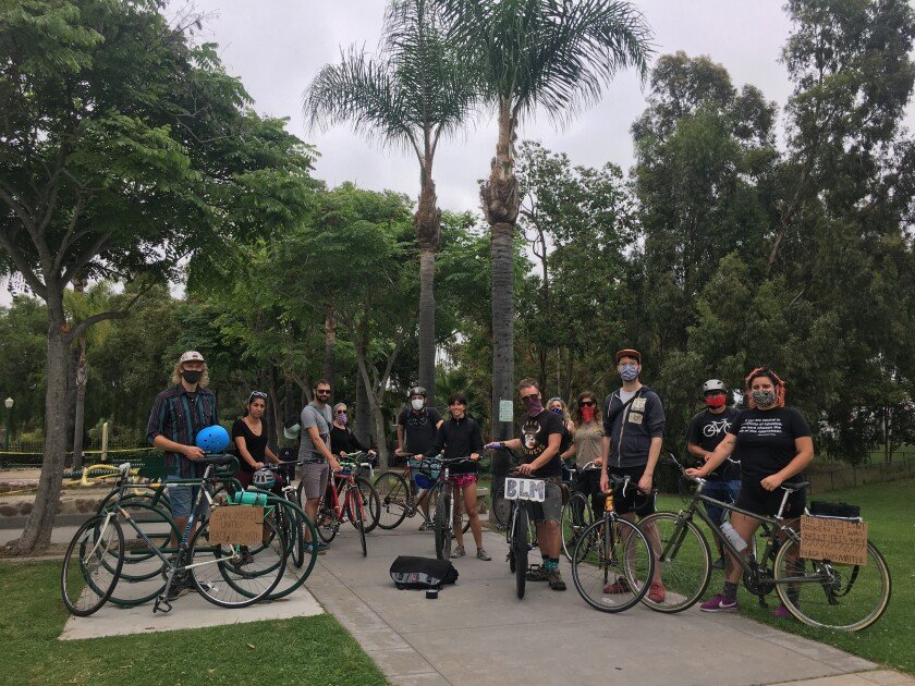 "Bicyclists gathered in University Heights for a ""Protest by Pedal."""