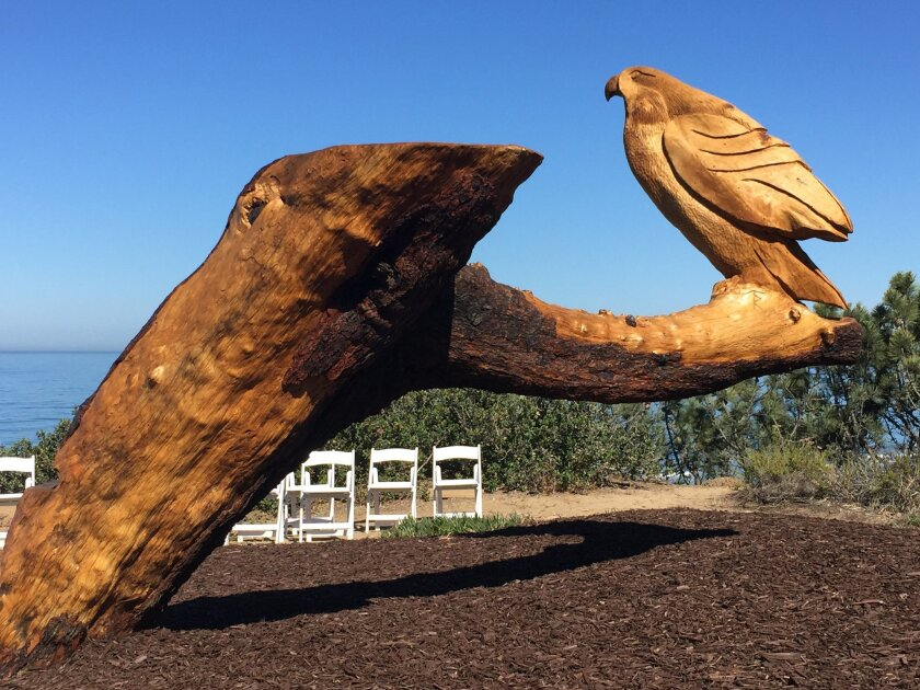 The sculpted tree also has a red-tailed hawk.