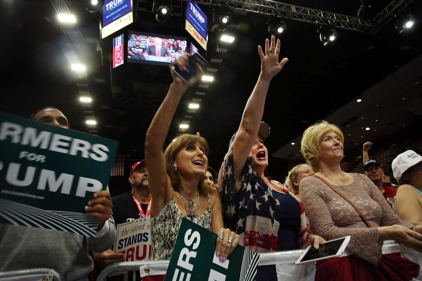 Women cheer as presumptive Republican presidential candidate Donald Trump speaks at a rally in Fresno on Friday.