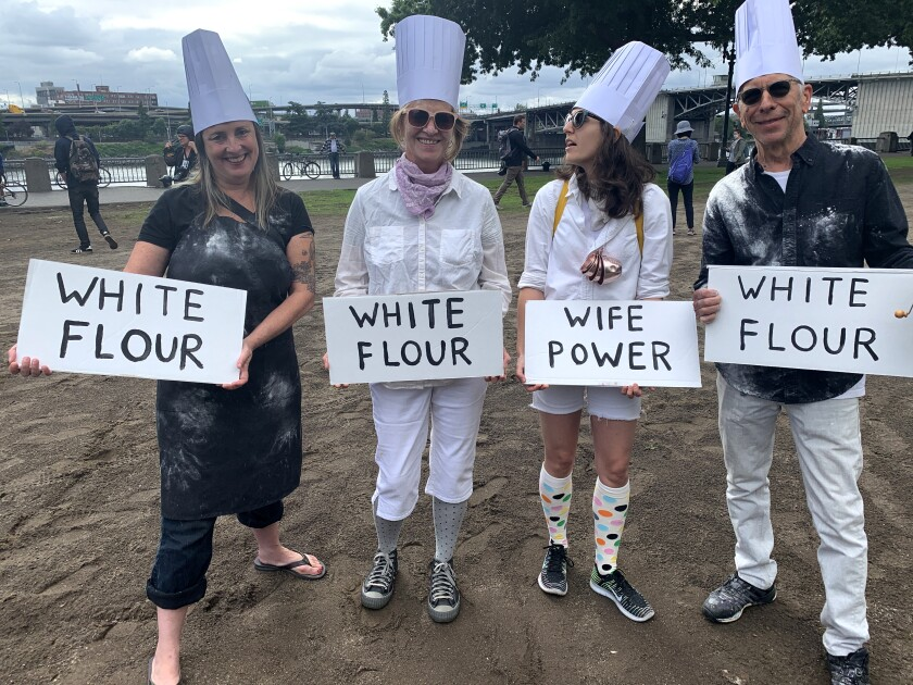 Portlanders display flour power Saturday, aiming to defuse hate and potential violence with humor