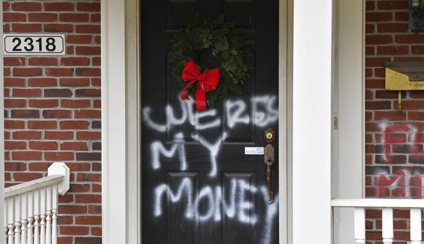 """Graffiti reading, """"Where's my money"""" is seen on a door of the home of Senate Majority Leader Mitch McConnell, R-Ky."""
