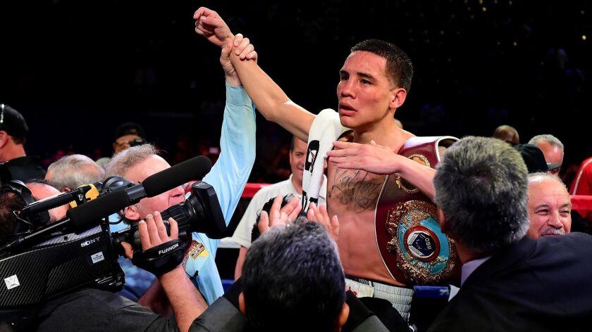 Oscar Valdez celebrates his unanimous 12-round decision over Miguel Marriaga on April 22, 2017, at StubHub Center.