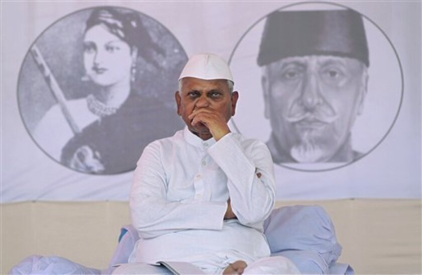FILE- In this Dec. 28, 2011 file photo, Indian anti-corruption activist Anna Hazare gestures during the second day of his hunger strike, in Mumbai, India. The anti-corruption movement that seemed to energize India's middle class just a few months ago, led by Hazare, the once-obscure social activist who defied the government with public hunger strikes and mass rallies, is facing a new enemy: apathy. (AP Photo/Rajanish Kakade, File)