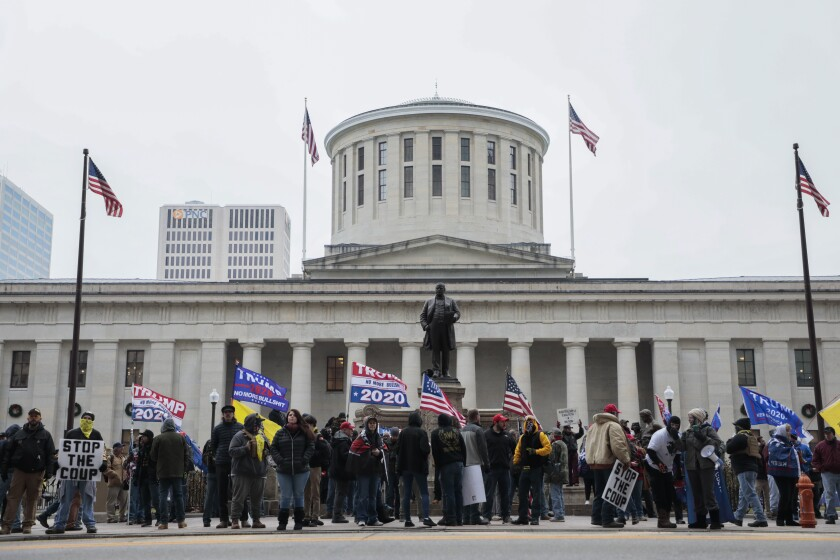 FILE - Supporters of President Donald Trump demonstrate during a rally on Wednesday, Jan. 6, 2021, at the Ohio Statehouse in Columbus, Ohio. Statehouses where Trump loyalists have rallied since the Nov. 3 election are heightening security after the storming of the U.S. Capitol this week. Police agencies in a number of states are monitoring threats of violence as legislatures return to session and as the nation prepares for the inauguration of President-elect Joe Biden. (Joshua A. Bickel/The Columbus Dispatch via AP, File)