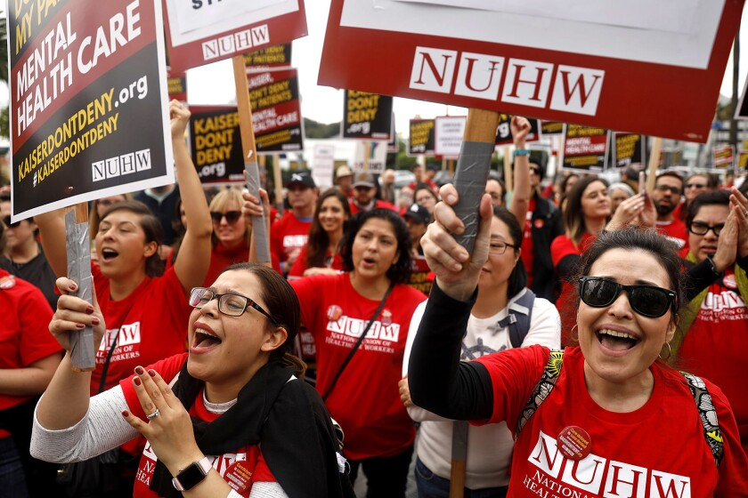Mental health workers rally outside the Kaiser Permanente hospital on Sunset Boulevard in Los Angeles during a five-day strike in December 2018.