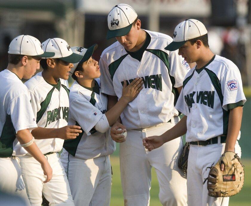 Luke Ramirez is literally head and shoulders above his Park View teammates. (John R. McCutchen / Union-Tribune)