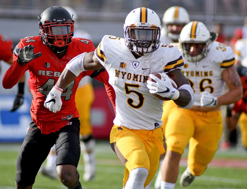 Wyoming Cowboys running back Brian Hill (5) rushes for a touchdown during a game against the UNLV Rebels at Sam Boyd Stadium.