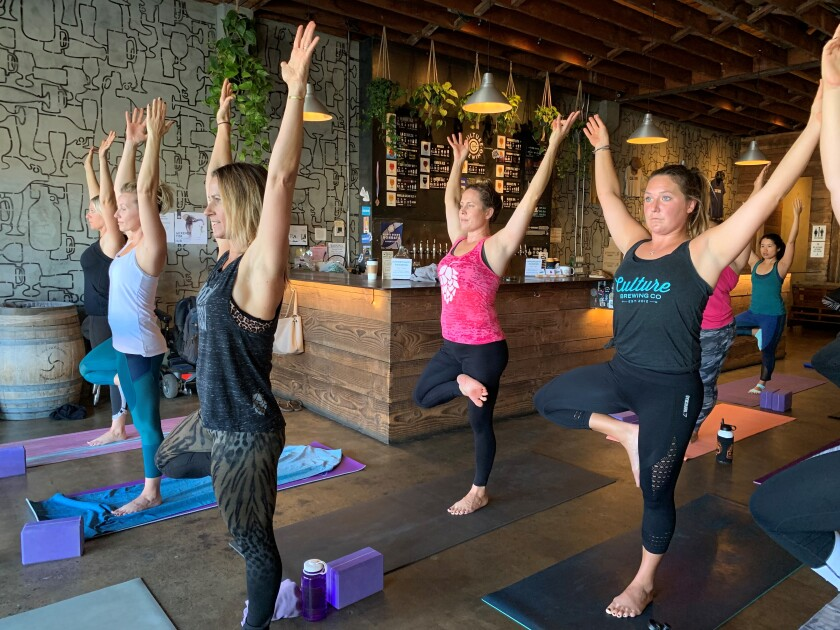 Hoppy Yoga instructors lead 75-minute sessions at various San Diego breweries.