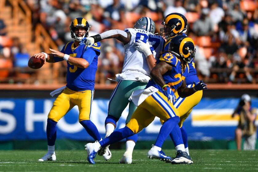 Rams quarterback Blake Bortles looks to throw to running back Darrell Henderson (27) on Saturday.