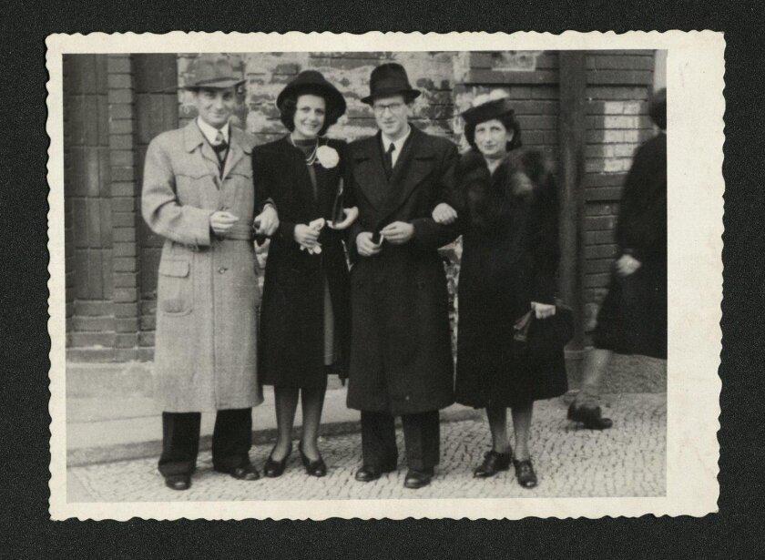 A wedding photograph of Henry and Inge Oertelt, center, taken on Sept. 25, 1946, in Berlin, Germany.