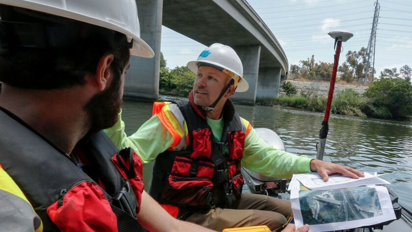 Caltrans bridge engineer Kevin Flora, right, and student assistant Rami Gharaibeh float up the San G