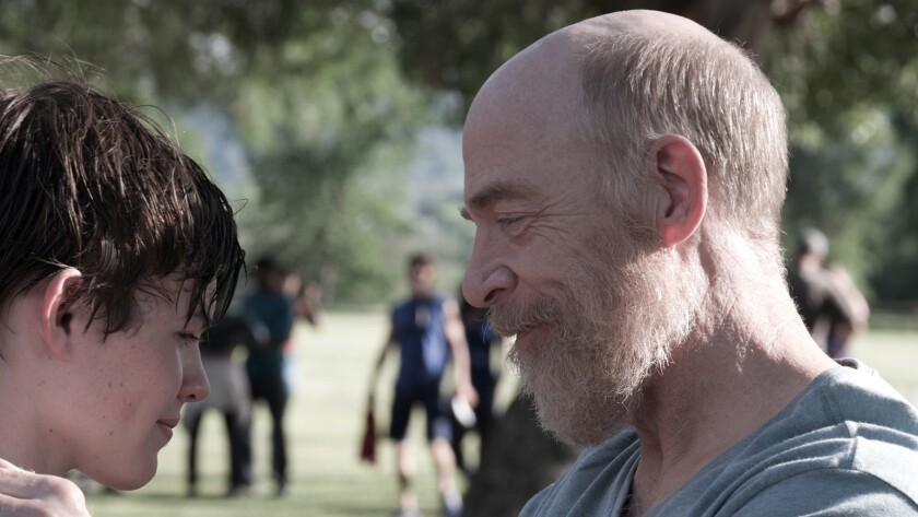 """Josh Wiggins, left, and J.K. Simmons star as a son and father dealing with loss in """"The Bachelors."""""""