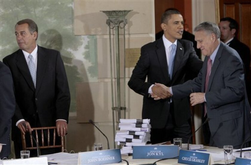 President Barack Obama greets Senate Minority Whip Jon Kyl of Ariz. in the Blair House in Washington, Thursday, Feb. 25, 2010, prior to the start of the health care reform summit. At left is House Minority Leader John Boehner of Ohio. (AP Photo/Pablo Martinez Monsivais)