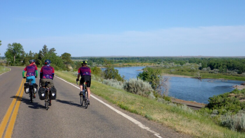 Dr. Paul Gordon, center, and fellow bikers ride west along the Yellowstone River in eastern Montana.