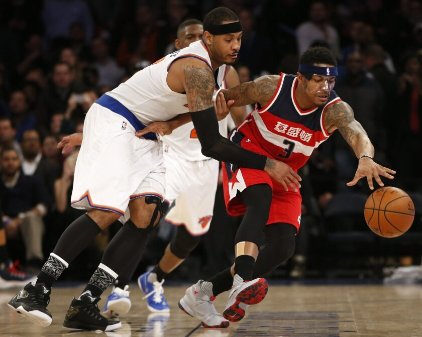 New York Knicks forward Carmelo Anthony (7) defends Washington Wizards guard Bradley Beal (3) in the second half of an NBA basketball game at Madison Square Garden in New York, Tuesday, Feb. 9, 2016. The Wizards defeated the Knicks 111-108. (AP Photo/Kathy Willens)