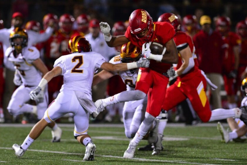 Cathedral Catholic's Antoine Lee shakes a Falcon defender in the Dons' 45-7 win over Torrey Pines in the CIF San Diego Section football quarterfinals on Nov. 18.