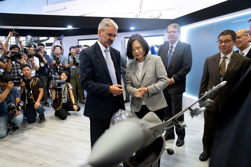 Taiwanese President Tsai Ing-wen looks at a U.S. F-16 jet mode