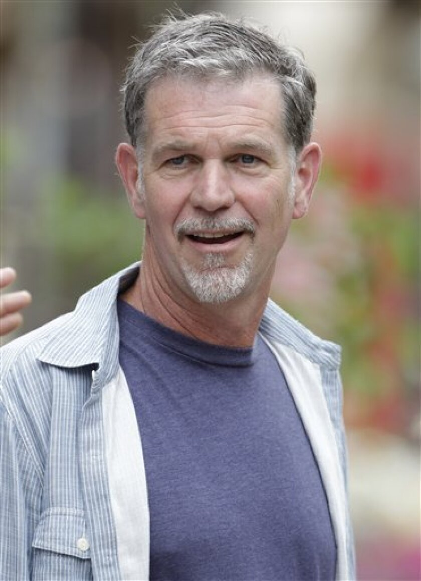 """FILE - In this July 11, 2012 file photo, Netflix CEO Reed Hastings attends the Allen & Company Sun Valley Conference in Sun Valley, Idaho. Netflix Inc. is facing scrutiny from government regulators for a Facebook post by Hastings in July that may have boosted the online video company's stock price. Neflix said Thursday, Dec. 6, 2012, that the Securities and Exchange Commission informed it that its staff is recommending civil action be brought against the company and Hastings. The reason: Hastings' July 3 post in which he said Netflix's online video viewing """"exceeded 1 billion hours for the first time ever in June."""" (AP Photo/Paul Sakuma, File)"""
