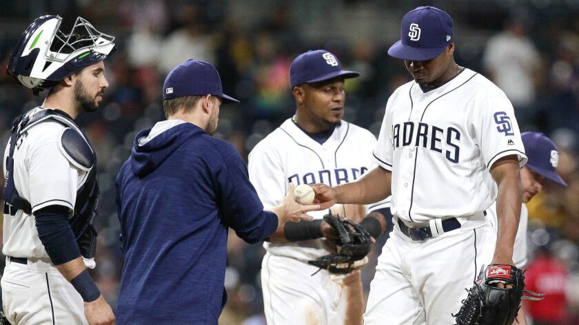 SAN DIEGO, June 28, 2017 | The Padres' starting pitcher Luis Perdomo hands manager Andy Green the ba