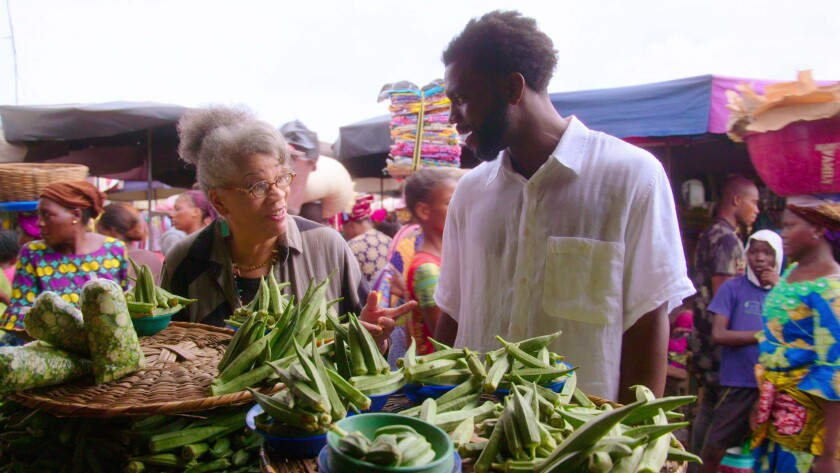 Stephen Satterfield and historian Jessica B. Harris explore a West African open-air market.