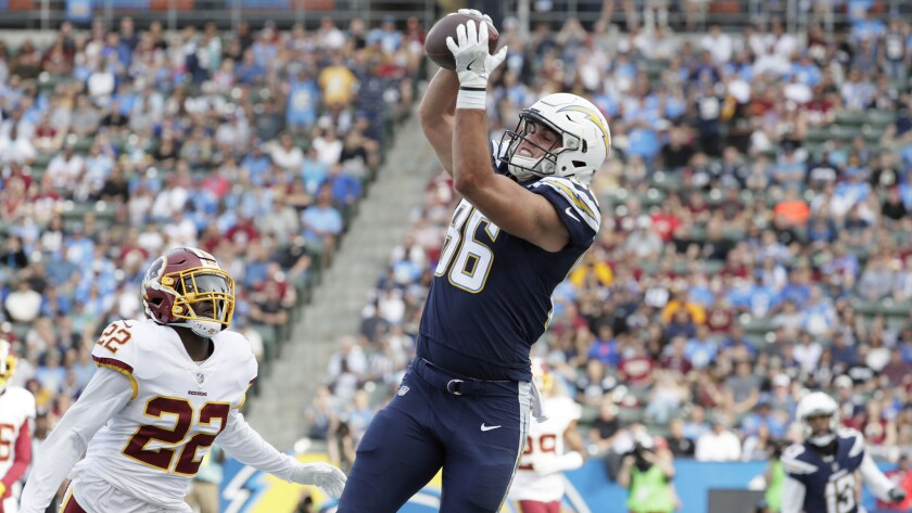 Chargers tight end Hunter Henry hauls in a touchdown pass over Redskins safety Deshazor Everett