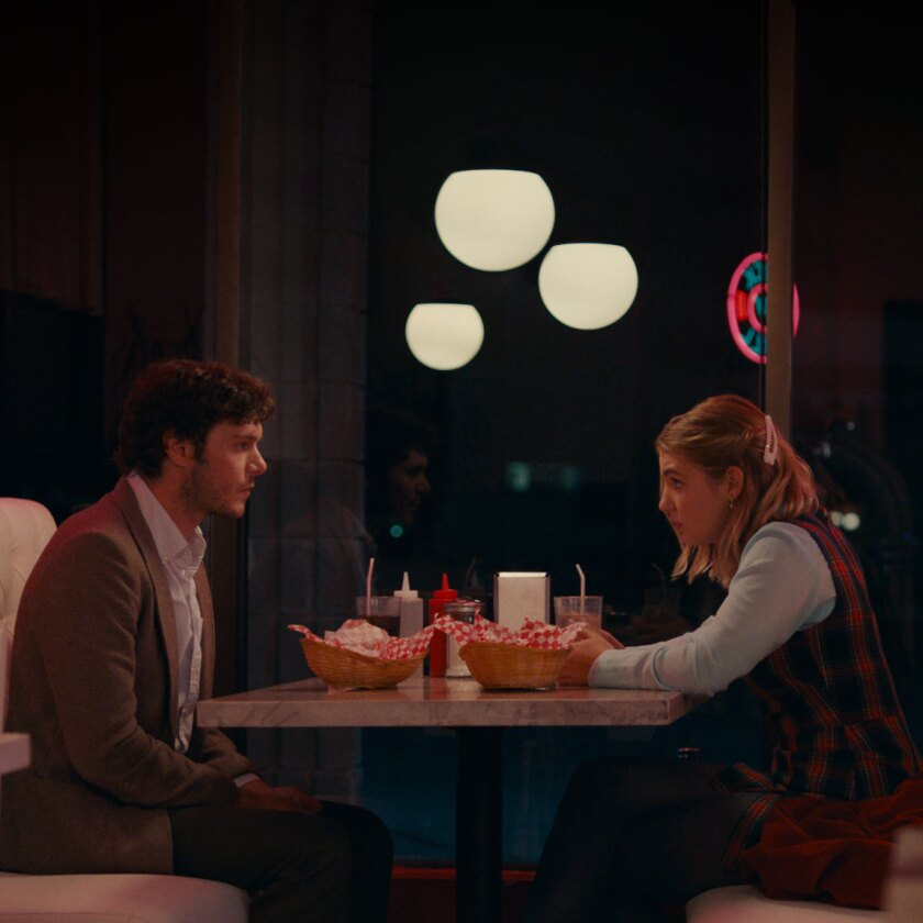 """The Kid Detective's"" Adam Brody and Sophie Nélisse in a diner scene."