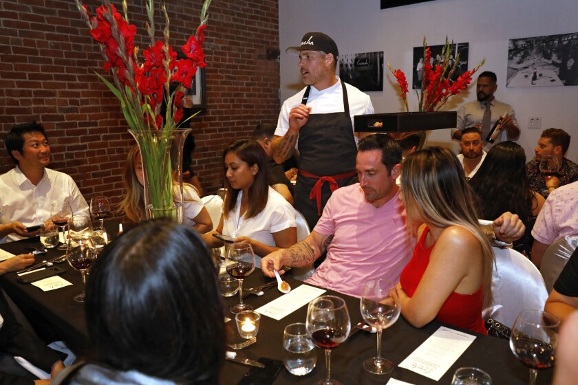 A photo of Steve Brown chatting with diners at Cosecha SD