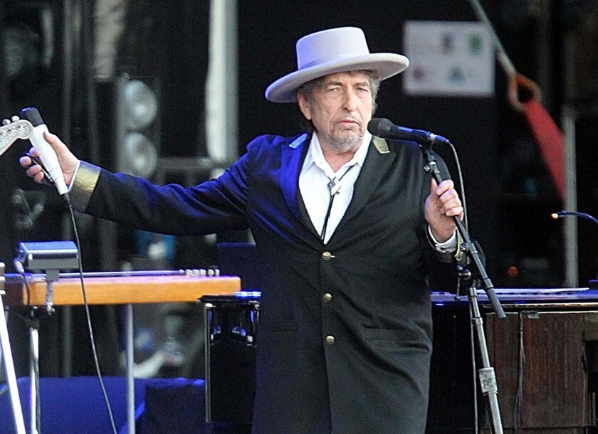 """FILE - This July 22, 2012 file photo shows U.S. singer-songwriter Bob Dylan performing on stage at """"Les Vieilles Charrues"""" Festival in Carhaix, western France. French authorities have filed preliminary charges against Bob Dylan over an interview in which he is quoted comparing Croatians to Nazis an"""