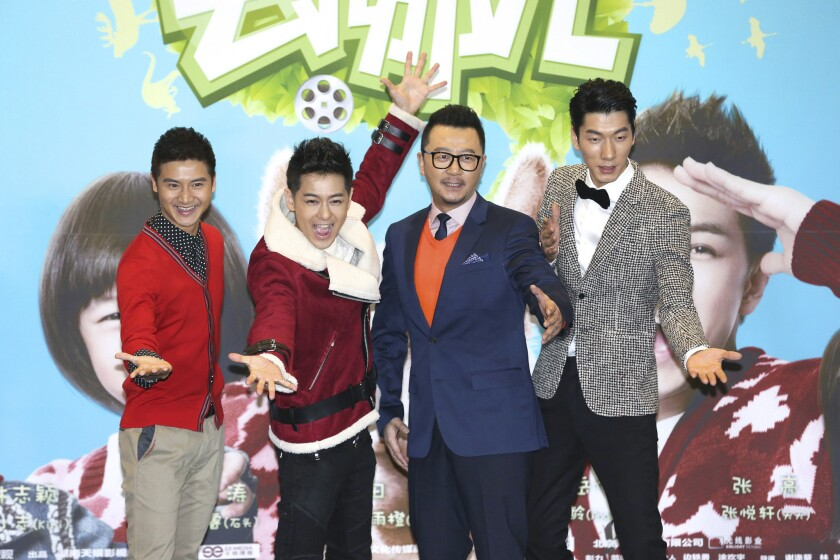 """Members of the cast of """"Dad, Where Are We Going"""" pose for photos at a news conference in Beijing last month. From left are Tian Liang, Jimmy Lin, Guo Tao and Zhang Liang."""