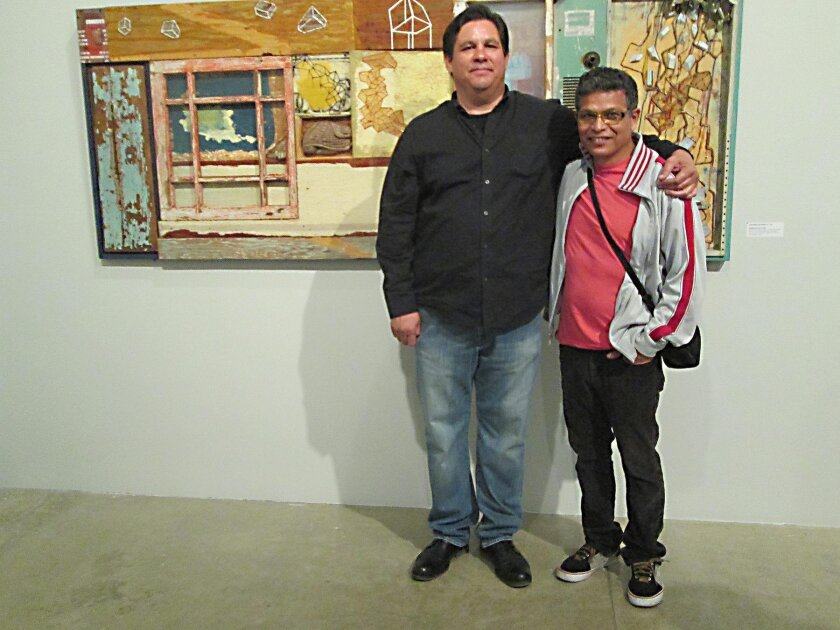 Alonso Elias with Alejandro Zacarías and one of Zacarías' collages