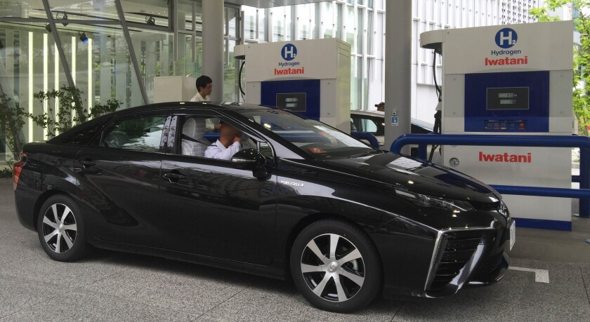 A hydrogen fuel cell car gets a fill-up at a Tokyo hydrogen station.