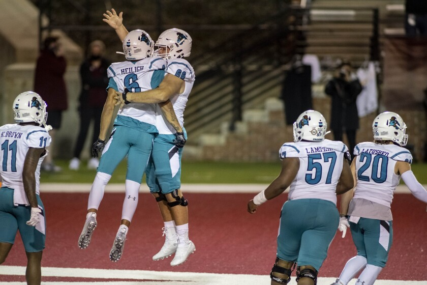 Coastal Carolina wide receiver Jaivon Heiligh (6) and teammate Will McDonald (66) celebrate Heiligh's touchdown against Troy during the second half of an NCAA college football game, Saturday, Dec. 12, 2020, in Troy, Ala. (AP Photo/Vasha Hunt)