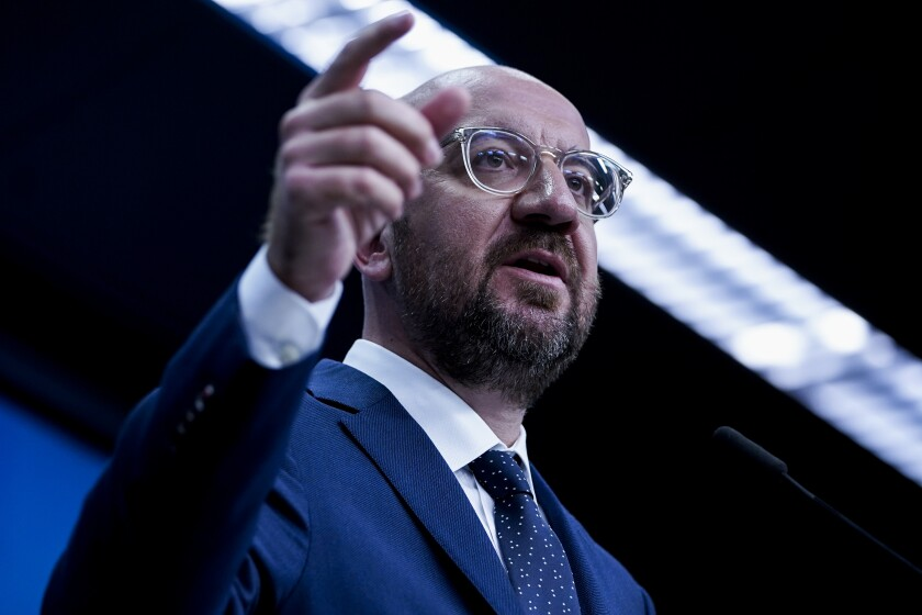 European Council President Charles Michel speaks during a media conference at the European Council building in Brussels, Friday, July 10, 2020. European Council President Charles Michel presented updated proposals for the EU's long-term budget and post-coronavirus recovery plan ahead of a summit next week in Brussels where heads of state and government leaders will try to agree on a compromise. (Kenzo Tribouillard, Pool Photo via AP)