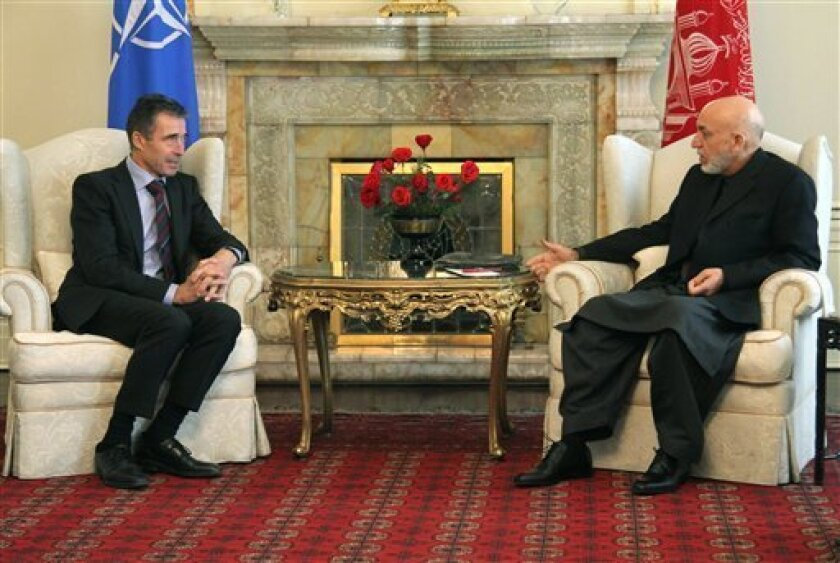 """NATO Secretary General Anders Fogh Rasmussen, left, meets with Afghan President Hamid Karzai in Kabul, Afghanistan, Monday, March 4, 2013. """"Afghanistan wants a real struggle against terrorism and wants the Pakistani government to realize that both our nations are burning in the same fire,"""" the Afgh"""