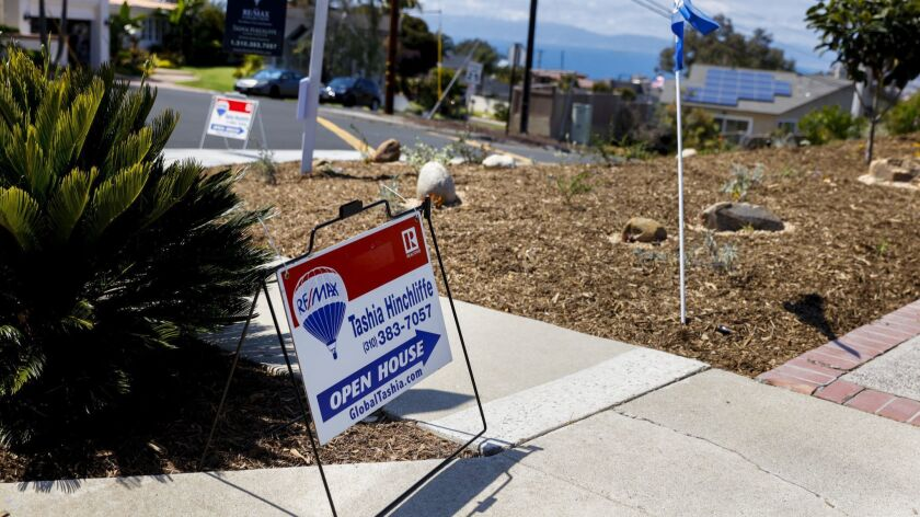 A sign points toward an open house in the Hollywood Riviera neighborhood of Torrance.