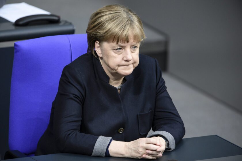 German Chancellor Angela Merkel attends a commemoration of the victims of the Berlin Christmas market attack held Jan. 19 in the German Parliament.