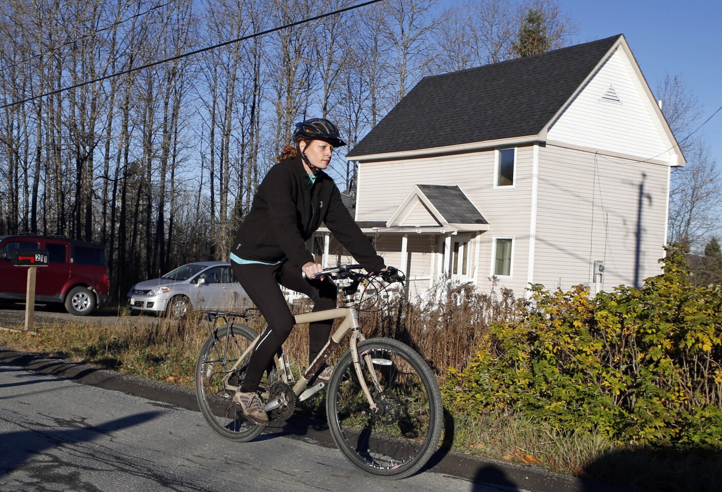 Nurse Kaci Hickox defies quarantine orders by leaving her home in Fort Kent, Maine, to take a bike ride with her boyfriend. State officials are going to court to keep Hickox in quarantine for the remainder of her 21-day incubation period for Ebola that ends on Nov. 10.